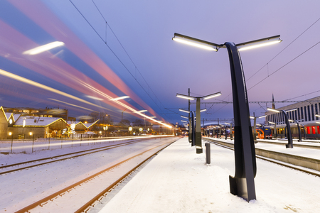 TALLINN, ESTONIA - DECEMBER 23, 2018: Train platform and light trails of passing train in Balti Jaam station in Tallinn, Estonia on December 23, 2018 Sajtókép