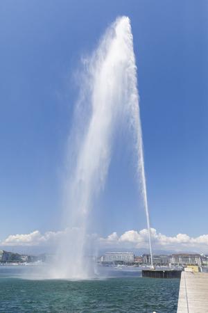GENEVA, SWITZERLAND - JUNE 30, 2018: 140m high fountain called Jet dEau in city centre of Geneva, Switzerland on June 30, 2018