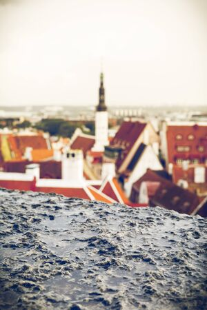 Closeup of wet limestone surface and old town of Tallinn in the background Stock fotó