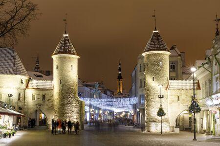 TALLINN, ESTONIA - DECEMBER 23, 2018: Illuminated curtain wall towers at Viru street in the old town of Tallinn, Estonia on December 23, 2018