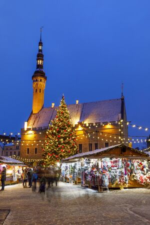 TALLINN, ESTONIA - DECEMBER 22, 2018: People visit christmas market in the old town of Tallinn, capital of Estonia on December 22, 2018