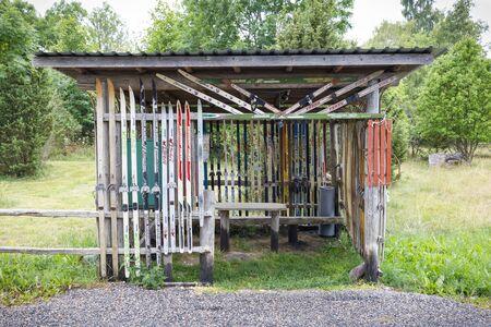 HIIUMAA, ESTONIA - JULY 29, 2018: Resting cabin decorated with old skies in Hiiumaa, Estonia in July 2018