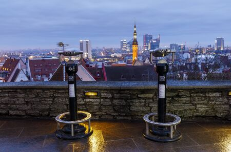 TALLINN, ESTONIA - DECEMBER 23, 2019: Silver colored viewing machine at viewpoint in the old town of Tallinn, Estonia