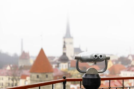 Closeup of a silver colored viewing machine at viewpoint in the old town of Tallinn, Estonia