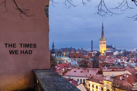 Illuminated church tower in the old town of Tallinn, Estonia at night