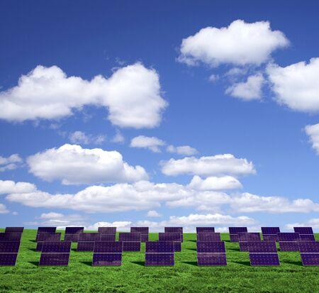 photons: Solar energy panels on a green field  Stock Photo