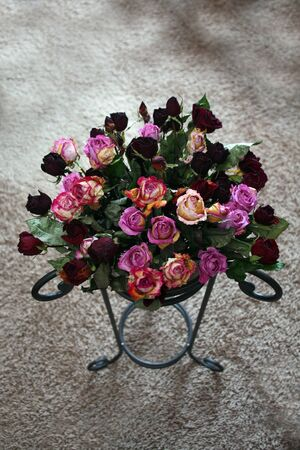 Bunch of dry red and pink roses