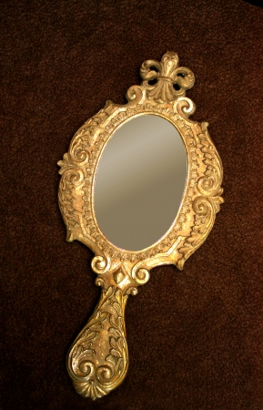 hand carved: Old brass hand-mirror Stock Photo