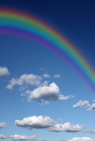 refraction of light: Rainbow in the sky with clouds