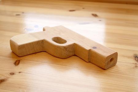 Wooden toy gun Stock Photo - 11697098