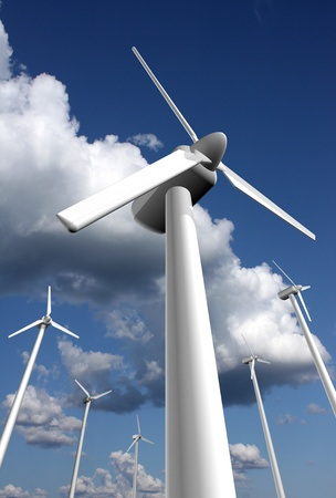 Wind power farm with sky and clouds in the background, dramatic perspective Stock Photo