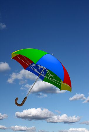 Colorful umbrella flying in the sky Stock Photo