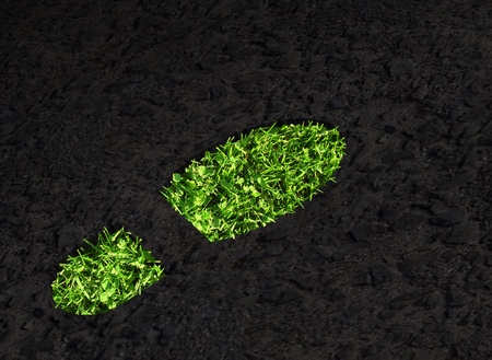 Green grass growing footprint on black asphalt Stock Photo - 11697101