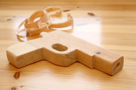 carpentery: Wooden toy gun with wood shavings
