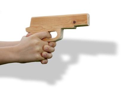 Wooden toy gun in child