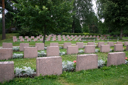 Rows of soldier graves in a graveyard