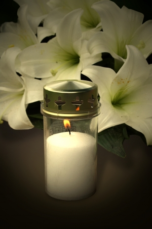 mourn: Candle and flowers for condolences