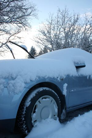 Winter car covered with fresh snow  Stock Photo