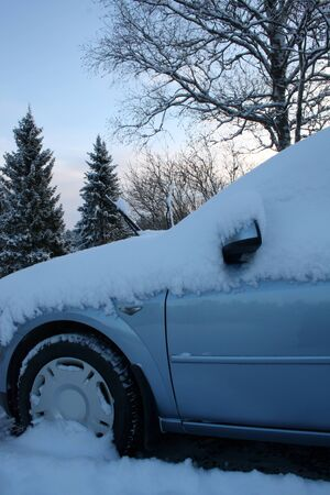 Car after winter day snowfall Stock Photo - 16657486