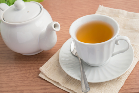 tea cup: A cup of green tea and a teapot Stock Photo
