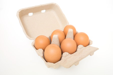 Eggs in egg carton isolated on white  photo