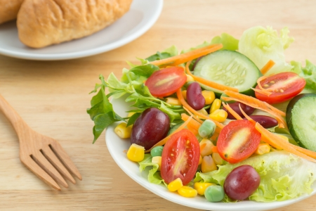 Fresh vegetable salad with bread photo