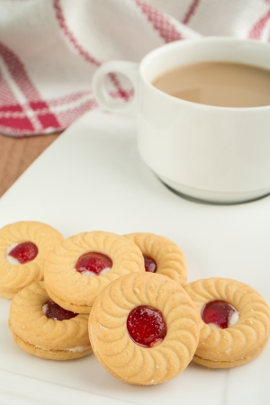 jam sandwich: Strawberry jam sandwich biscuits with coffee cup
