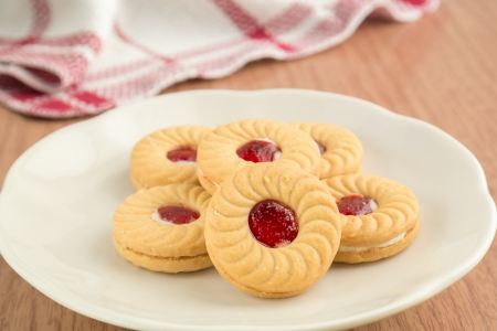 jam sandwich: Strawberry jam sandwich biscuits on white plate Stock Photo