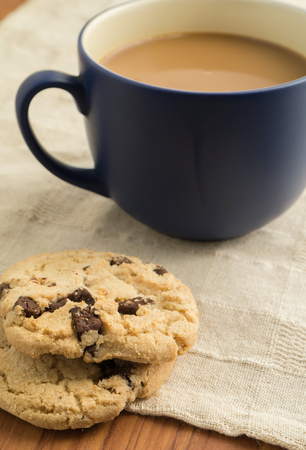 Closeup of chocolate chip cookies and mug of coffee photo