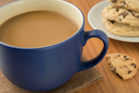 A mug of coffee and chocolate chip cookies photo