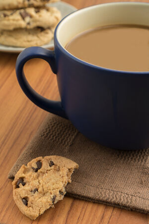 Chocolate chip cookies and a coffee mug   photo