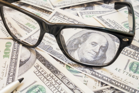 lens unit: Dollar bills viewed through glasses