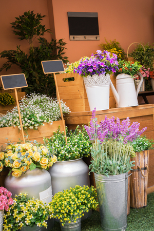 Colorful artificial flowers in flower shop photo