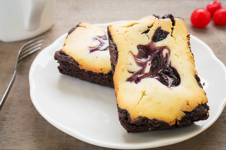 Cheesecake brownies with coffee cup photo