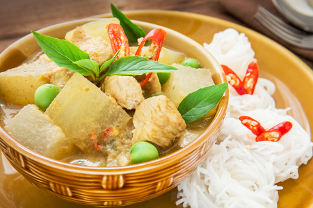 Green curry chicken with wax gourd and noodles, Thai food photo
