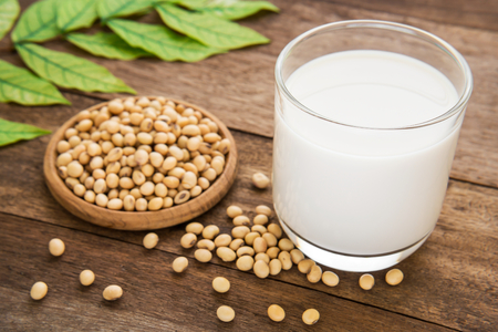 Soy milk and soy bean on wooden table Stock Photo