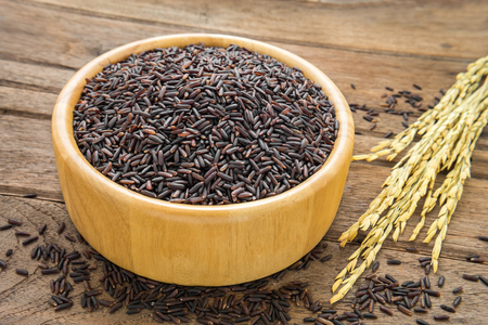 wild rice: Black rice in bowl on wooden table Stock Photo