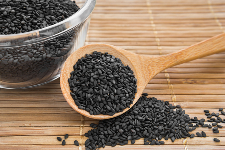 Black sesame on wooden spoon Stock Photo