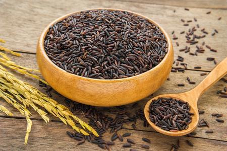 black rice: Black rice in wooden bowl Stock Photo