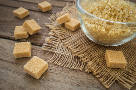 brown sugar: Brown sugar cubes on wooden table