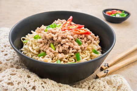minced meat: Instant noodles with pork in bowl