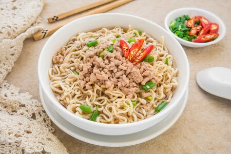 cooked instant noodle: Instant noodles with pork in bowl