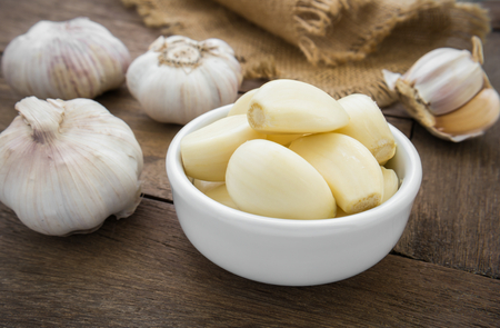 garlic: Peeled garlic in bowl Stock Photo