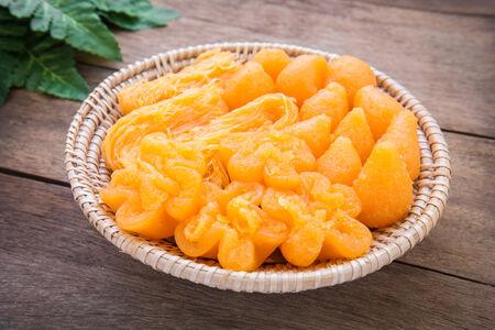 sweetmeat: Thai dessert golden sweetmeat in wicker basket