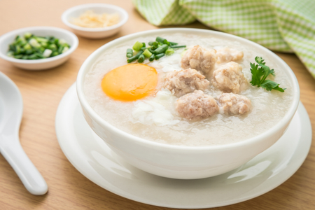 vegetable soup: Congee with minced pork and boiled egg in bowl