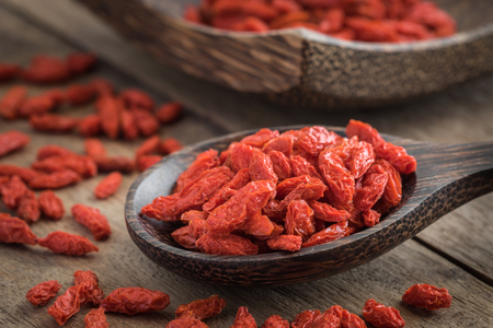 Goji berries on wooden spoon Stock Photo
