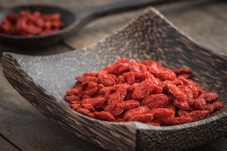 chinese herbs: Goji berries on wooden plate and spoon