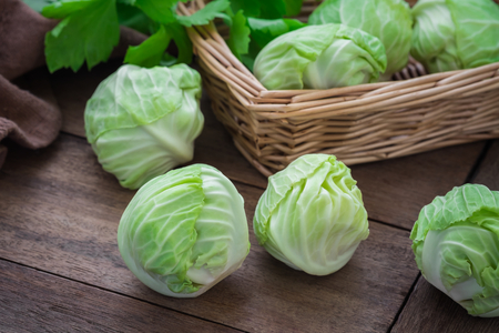 basket: Cabbage on wooden table and basket Stock Photo