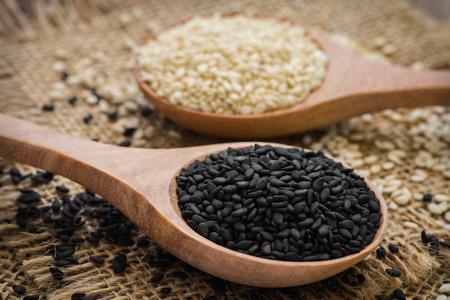 black sesame: Black sesame and white sesame seed on wooden spoon Stock Photo