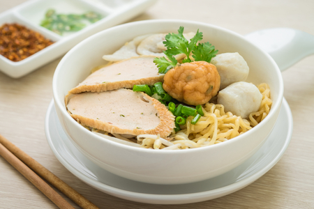 Noodles with fish balls in bowl